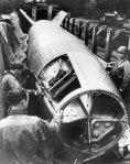 American soldiers inspect a V-2 rocket captured intact in April 1945.