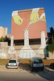 L'opera dello street artist Blu a Sassari (Piazza Aldo Moro a Carbonazzi)