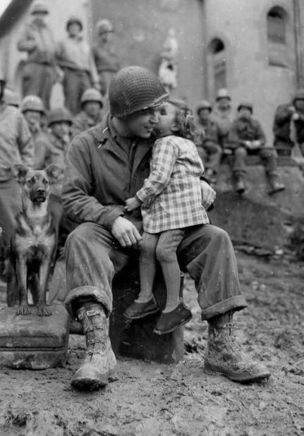 9th Armored Division technician with a little French girl on Valentine's Day - 1945