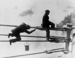 Brooklyn Bridge painters at work high above the city - 1915