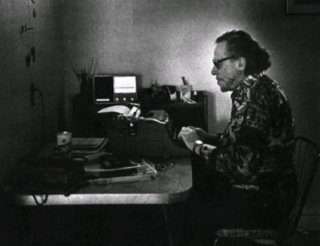 """Charles Bukowski, photo by Joan Levine Gannij, 1988 """"Yet each night as I sit down to this machine with my bottle ... these keys keep meting out a substantial energy of cockeyed miracle."""""""