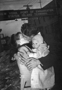 Officer returns home to his bride and new baby. World War ll