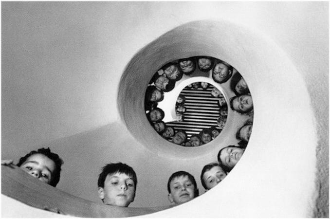 """Children over a Fibonacci Spiral Staircase"" by Martine Franck"