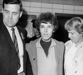Detective Frederick Stepat and policewoman McCarthy escort V