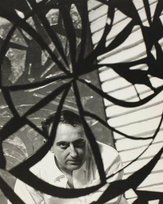 Enrico Baj's portrait on a mirror , ca. 1960. Fotografia di Ugo Milas