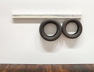 Pedro Cabrita Reis One Line (Horizontal), Two Circles Underneath 2014 enamel on welded aluminium tubing, found car tires 76 x 208 x 23,5 cm