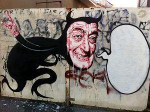 """David Diavù Vecchiato, """"Totòbolik"""". Stencil su cancello in ferro. via dei Quintili Roma - 2015 (per progetto MURo - Museo di Urban Art di Roma)"""