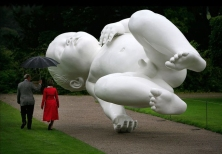 """""""Planet"""" (2008) by Marc Quinn (Painted bronze and steel - 398h x 926w x 353d cm)"""