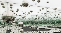 "Yayoi Kusama, Infinity Mirrored Room—Let's Survive Forever, 2017, wood, metal, glass mirrors, LED lighting system, monofilament, stainless steel balls, carpet, 10' 3"" x 20' 6"" x 20' 5 1/4"""