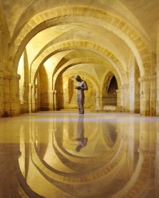 """""""Sound II"""" (1986) by Antony Gormley (a cast from the artist's own body), standing beneath Winchester Cathedral"""