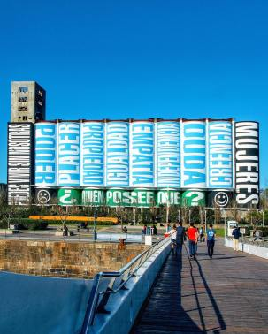 """Art Basel Cities Week in Buenos Aires: Barbara Kruger, """"Untitled (No puedes vivir sin nosotras / You Can't Live Without Us)"""", 2018, painted mural, Silos de la Antigua Junta Nacional de Granos, Buenos Aires, approximate dimensions 98 ft x 226 ft"""