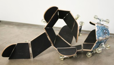 Darío Escobar - Untitled [Skateboard] (2011), wood, urethane, paint, stainless steel, 75 x 45 x 0.75 in. Photo courtesy of the artist and Josée Bienvenu Gallery