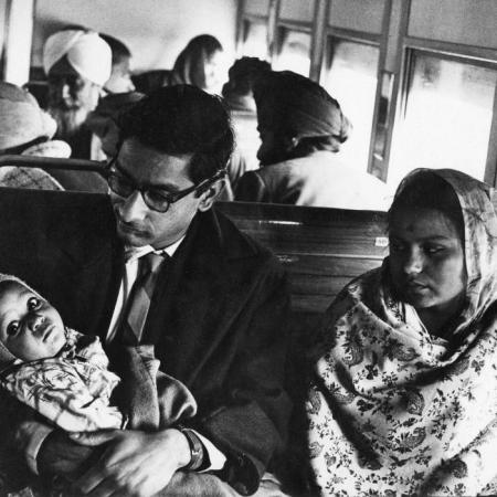Museum number PHY.07736 T. S. Satyan, Young couple and baby on a train journey, 1970, H. 26.6 cm, W. 35.3 cm, Silver gelatin print