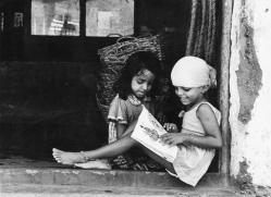 Museum number PHY.07748 T. S. Satyan, Homework after bath, 1978, H. 23.4 cm, W. 30.2 cm, Silver gelatin print