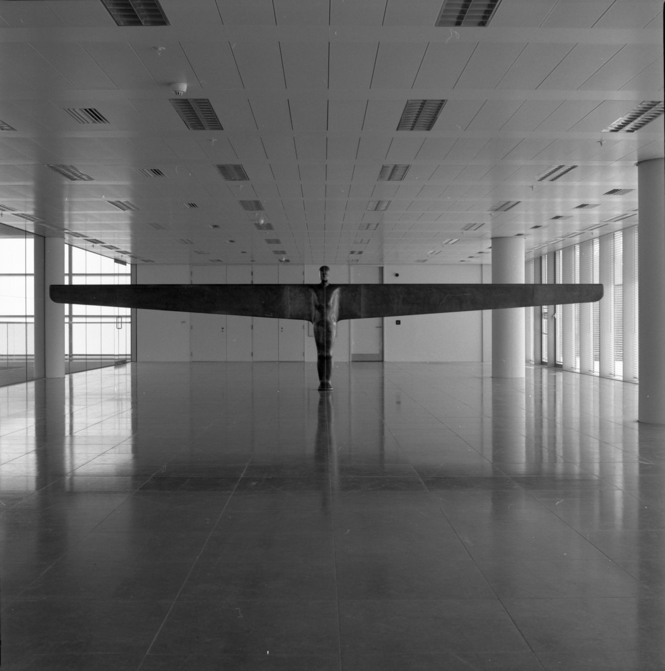 Antony Gormley, Case for an Angel II, 1990, in the exhibition 'Air and Angels', ITN Building, 200 Gray's Inn Road, London, 1994. Photography by Edward Woodman