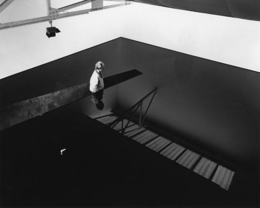 Richard Wilson, standing in the original installation of 20.50, Matt's Gallery, London, 1987. Photo by Edward Woodman