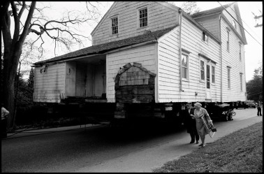 USA. CT. Shelton. Elderly couple walking away from the house they just donated to the Historical Society.