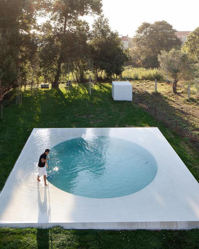 """Architect Guilherme Machado Vaz takes influence from the early modernist movement with the """"Afife House"""" in northern Portugal. The residence faces away from the road and toward an artfully planned swimmingpool in the yard. Photography by Jose Campos"""