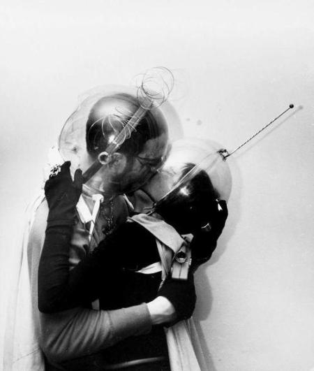 "Boy Meets Girl - From Mars A young man and woman with bubble helmets ""kiss"", New York, New York, mid 1950s. (Photo by Weegee (Arthur Fellig) International Center of Photography/Getty Images)"