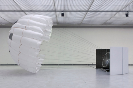 Pionier (2011) by Carsten Nicolai @ - Pace Gallery, New York Pionier I, a white silk parachute inflated with a wind machine, and raster gradient, a large-scale black-and-white gradient that optically expands and contracts the space of the gallery.