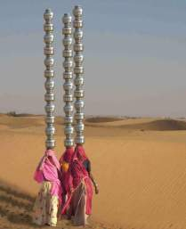 Women fetching water from kilometers away during summers in Adyar, India Photography by author unknown