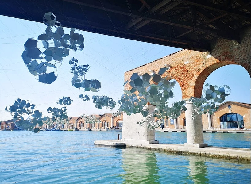 Aero(s)cene by Tomás Saraceno @ Biennale Arte 2019 - The aero(s)cene installation at the gaggiandre of the arsenale addresses the rising sea phases of global warming image © designboom