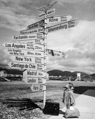 Little girl by the signpost at Bodö Airport, Norway, 1968. Photograph via SAS Scandinavian Airlines.