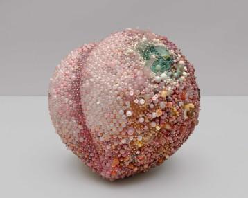 """Bad Peach"" (2019), rose quartz, agate, carnelian, pink opal, rhodonite, rhodochrosite, calcite, amber, quartz, fluorite, tree agate, magnesite, turquoise, serpentine, bone, coral, jasper, tiger eye, labradorite, red malachite, mother of pearl, glass, steel pins on coated polystyrene, 15.5 x 16.5 x 16 inches"