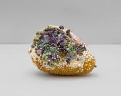 """Soft Spot"" (2019), amber, amethyst, rhodonite, rose quartz, serpentine, tree agate, jungle jasper, smokey quartz, garnet, agate, turquoise, olive jade, bone, pink lepidonite, glass, steel pins on coated polystyrene, 6 x 8 x 6 in"