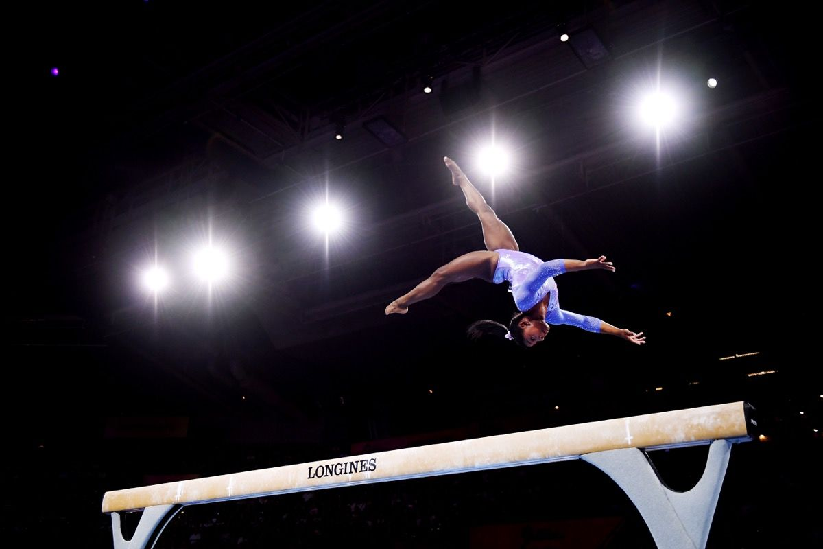 STUTTGART, GERMANY - OCTOBER 13: Simone Biles of The United States competes in Women's Balance beam Final during day 10 of the 49th FIG Artistic Gymnastics World Championships at Hanns-Martin-Schleyer-Halle on October 13, 2019 in Stuttgart, Germany. (Photo by Laurence Griffiths/Getty Images)