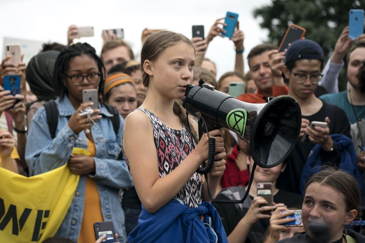 """WASHINGTON, DC - SEPTEMBER 13: Swedish youth climate activist Greta Thunberg delivers brief remarks surrounded by other student environmental advocates during a strike against climate change outside the White House on September 13, 2019 in Washington, DC. The strike is part of Thunberg's six day visit to Washington ahead of the """"Global Climate Strikes"""" on Friday September 20. (Photo by Sarah Silbiger/Getty Images)"""
