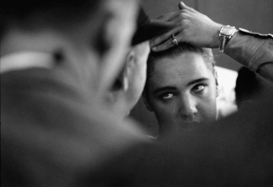 Private Elvis Presley combing his hair, 1958 Photograph: Courtesy of Monroe Gallery