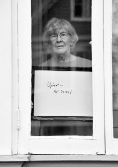 Artist Shirley Fuerst poses for 'Words At The Window: Self Isolation And The Coronavirus', a portrait series by Shutterstock Staff Photographer, Stephen Lovekin, shot around the Ditmas Park neighborhood of Brooklyn, New York.