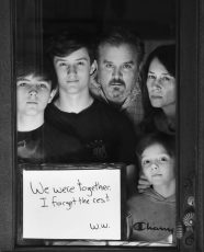 Mike Pergola and Denise Pergola with children Henry, Jack, and Will, pose for 'Words At The Window: Self Isolation And The Coronavirus', a portrait series by Shutterstock Staff Photographer, Stephen Lovekin, shot around the Ditmas Park neighborhood of Brooklyn, New York.
