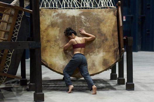 Chen Zhen Jue Chang, Dancing Body – Drumming Mind (The Last Song), 2000 Installation view and performance, Pirelli HangarBicocca, Milan, 2020, PINAULT COLLECTION © ADAGP, Paris Courtesy Pirelli HangarBicocca, Milan Photo: Francesco Margaroli