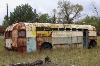 Abandoned trolleybus, Kopachi, Chernobyl Exclusion Zone. This highly contaminated village was mostly bulldozed after the disaster. In April 2020 this vehicle was severely damaged by forest fires. Chernobyl Exclusion Zone by Darmon Richter