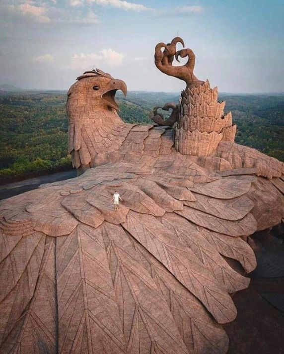 Artist Rajiv Anchal and a team of experience sculptors installed an enormous concrete bird named Jatayu, the largest bird sculpture in the world, atop the rolling hills of Chadayamangalam in the Kollam district of Kerala, India