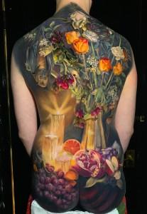 Elaborate chiaroscuro tattoo by Makkala Rose